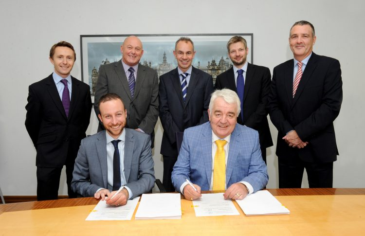 Signing of the refinance of Northern Bear Signing are John Bullock, Yokshire Bank and Graham Jennings Northern Bear Looking on are  Paul Castle, Eversheds, Keith Soulsby, Northern Bear, Steve Roberts, Tom Hayes Sean Hale of Yorkshire Bank