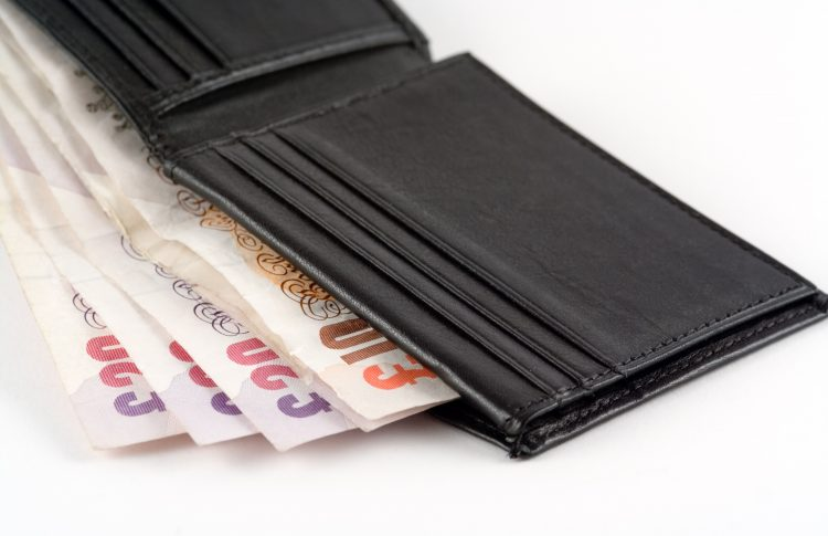 open wallet containing UK bank notes
