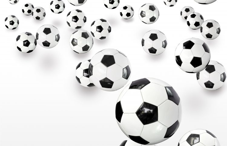 Lots of footballs against white background